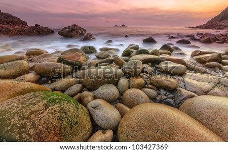 Porth Nanven cove in West Cornwall is a fine example of a glacial valley, the rock formations are smooth and rounded, the valley is near St Just has the Brison rocks not far offshore.