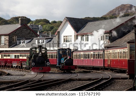 Porthmadog Train Station with steam strains on the rails Snowdonia National Park
