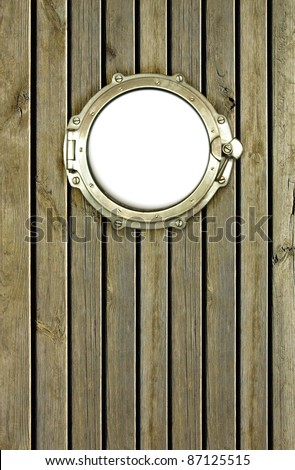 Porthole on the wooden background at pirate ship. Ship porthole as a circle frame, isolated on white.  Ship window on the old nautical vessel.