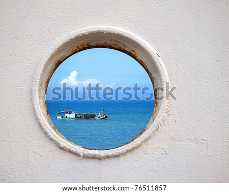 Porthole view of a Chinese fishing boat on the East China Sea