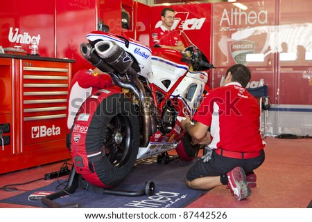 PORTIMAO, PORTUGAL - OCTOBER 16: Athea team prepares the motorcycle of the Superbikes World Championship first place winner, Carlos Checa. Superbikes , Algarve, Portimao on October 16, 2011. - stock photo