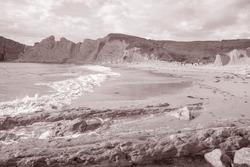 Portio Beach in Santander, Cantabria, Spain in Black and White Sepia Tone