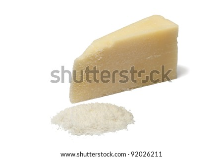 Portion and grated Parmesan cheese on white background