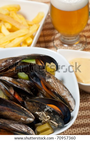 Portion of Belgian style mussels, steamed with vegetables