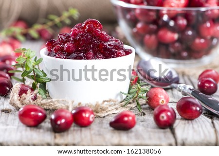 Portion of Cranberry Jam (with fresh fruits) - stock photo