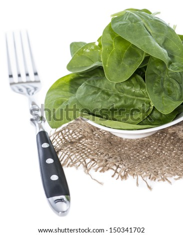 Portion of fresh Spinach Leaves isolated on white background
