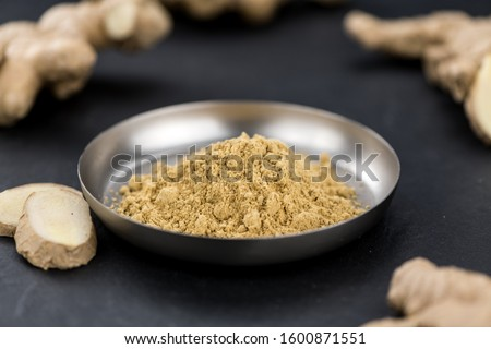 Portion of Ground Ginger as detailed close-up shot; selective focus