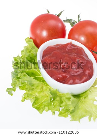 Portion of Ketchup isolated on white background