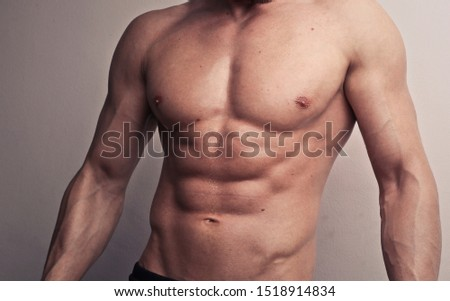 portion of naked torso of muscular man