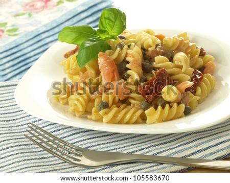 Portion of pasta salad with salmon and tomatoes