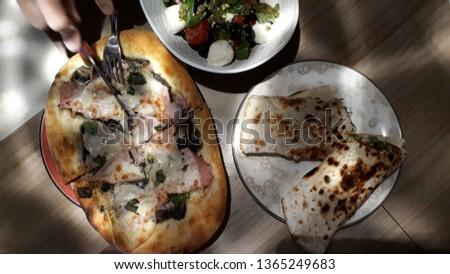Portions of a handmade homemade carbonara pizza with mushrooms