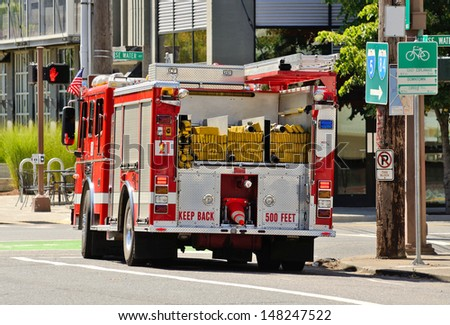 PORTLAND, OR - JULY 14, 2013: A fire engine responds to a medical emergency in the industrial areal of Portland Oregon on July 14th, 2013