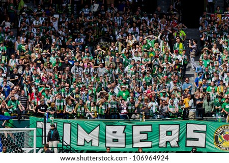PORTLAND, OR - JUNE 24: Timbers Army shows support of the Portland Timbers team during Seattle Sounders vs. Portland Timbers game, on June 24, 2012 at Jeld-Wen Field in Portland, OR.