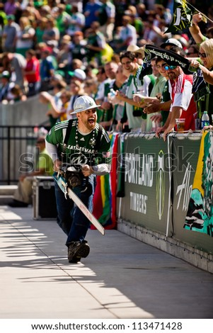 PORTLAND, OR - SEPT 15: Timber Joey revs up the fans with his chainsaw before the game Seattle Sounders vs Portland Timbers, on Sep 15, 2012 at Jeld-Wen Field in Portland, OR.