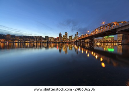 Portland Oregon Downtown City Skyline Along Willamette River by the Hawthorne Bridge at Evening Blue Hour