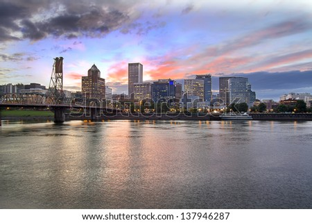 Portland Oregon Downtown City Skyline with Historic Hawthorne Bridge Across Willamette River at Sunset. Best for smaller scale.