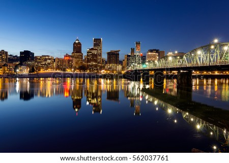 Portland Oregon downtown skyline along Willamette River during blue hour winter night scene