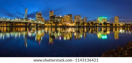 Portland Oregon Downtown Waterfront City Skyline by Hawthorne along Willamette River during Blue Hour Panorama #1143136421