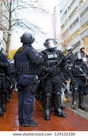 PORTLAND, OREGON - NOV 17: Police Sergeant and Cops in Riot Gear in Downtown Portland, Oregon during a Occupy Portland protest on the first anniversary of Occupy Wall Street November 17, 2011