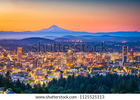 Portland, Oregon, USA skyline at dusk with Mt. Hood in the distance.