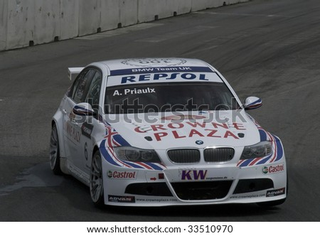 PORTO, PORTUGAL - JULY 5: ANDY PRIAULX of UK in his BMW team UK participates in the FIA WORLD TOURING CAR CHAMPIONSHIP on July 5, 2009 in Porto, Portugal
