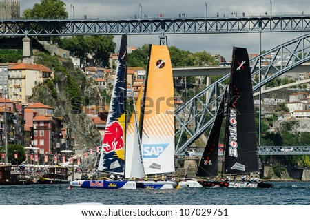 PORTO, PORTUGAL - JULY 07: Participants compete in the Extreme Sailing Series boat race on july 07, 2012 in Porto, Portugal.