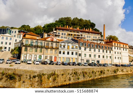 PORTO, PORTUGAL - JUN 21, 2014: Architecture on the bank of Douro river of Porto, the second largest city in Portugal and it was called the European Culture Capital in 2001 #515688874