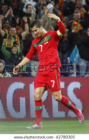PORTO, PORTUGAL - OCTOBER 8: Cristiano Ronaldo (POR) calling his companions to celebrate Portugal's 3rd goal in the Euro 2012 Qualifying match against Denmark on October 8, 2010 in Porto, Portugal
