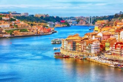 Porto, Portugal old town ribeira aerial promenade view with colorful houses, Douro river and boats