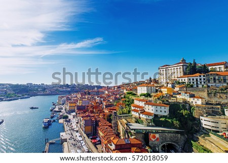 Porto, Portugal old town skyline from Dom Luis bridge on the Douro River #572018059