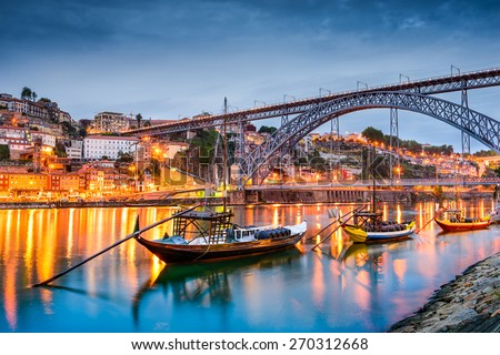 Porto, Portugal old town skyline on the Douro River with rabelo boats.