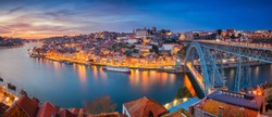Porto, Portugal. Panoramic cityscape image of Porto, Portugal with the famous Luis I Bridge and the Douro River during dramatic sunset.