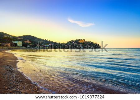 Porto Santo Stefano, headland and bay beach at sunset in Monte Argentario, Maremma Tuscany, Italy #1019377324
