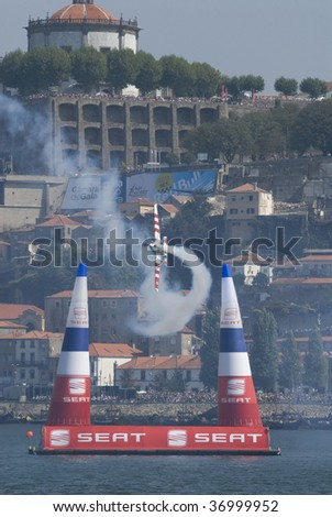 PORTO - SEPTEMBER 13, 2009: Paul Bonhomme  of the GBR participates in the Red Bull Air Race in September 13, 2009 in Porto in Portugal.