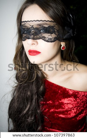 Portraid Lady in red with lace on a face