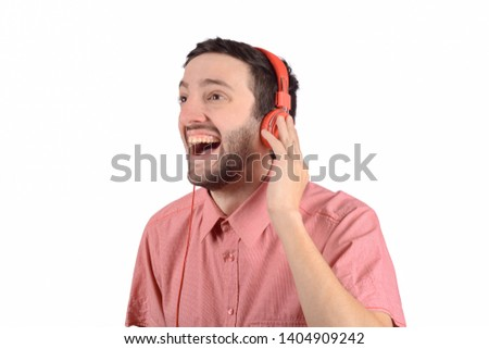 Young Male Listening Music In Headphones Isolated On Black