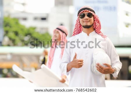 Portrait Arab business man working in the city #768542602