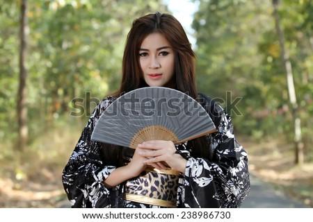 portrait Asia Beautiful Japanese kimono women and Japanese geisha women with Folding Fan and traditional fan
