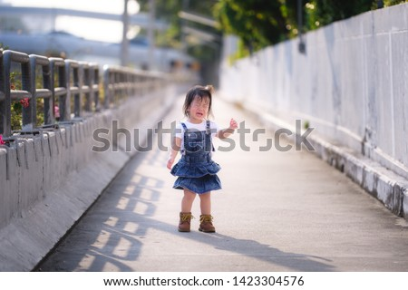 Portrait Asian Baby Child Girl. Two-year-old are struggling with their reliance on their parents and their desire for independence.