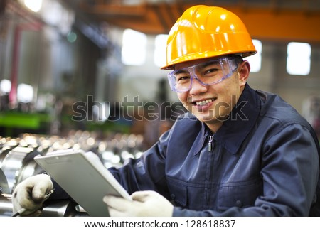 Portrait asian engineer with checklist look on you camera