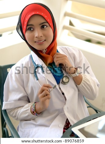 Portrait asian female Muslim doctor with tablet