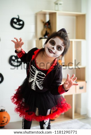Portrait Asian little girl in Halloween costume acting scary and frightening expression for Halloween festival #1181290771
