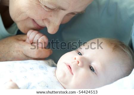 Portrait baby with happy grandmother