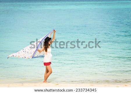 Portrait beautiful Asian girl and beautiful beach and sea, Lipe island, Andaman sea, Thailand.