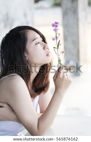 Portrait beautiful Asian girl front of cement wall #565876162