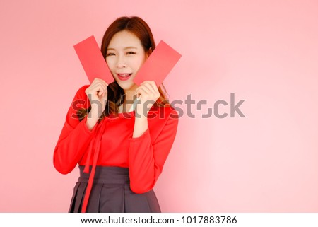Portrait beautiful asian woman wearing red modern hanbok dress korea style on pink background with red envelopes holding in hand, celebrate chinese new year concept - Shutterstock ID 1017883786