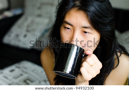 portrait beautiful asian women holdind cup of coffee after waking up