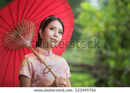 Portrait beautiful Chinese girl with dress traditional concept,copy space for text