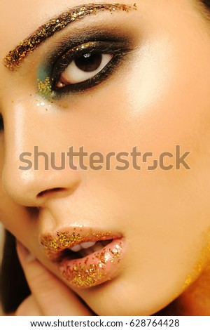 Portrait. Beautiful girl, brunette. Creative make-up. Sequins. #628764428