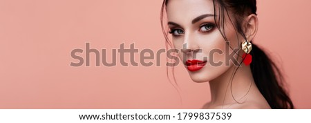 Photo of  Portrait beautiful woman with jewelry on colored background